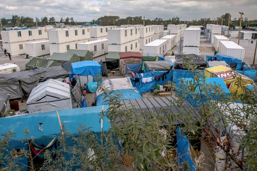 """A photo shows a view of the """"Jungle"""" migrant camp in Calais on Oct 12, 2016."""