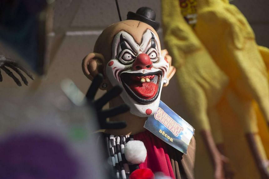 A clown mask for sale at a costume store.