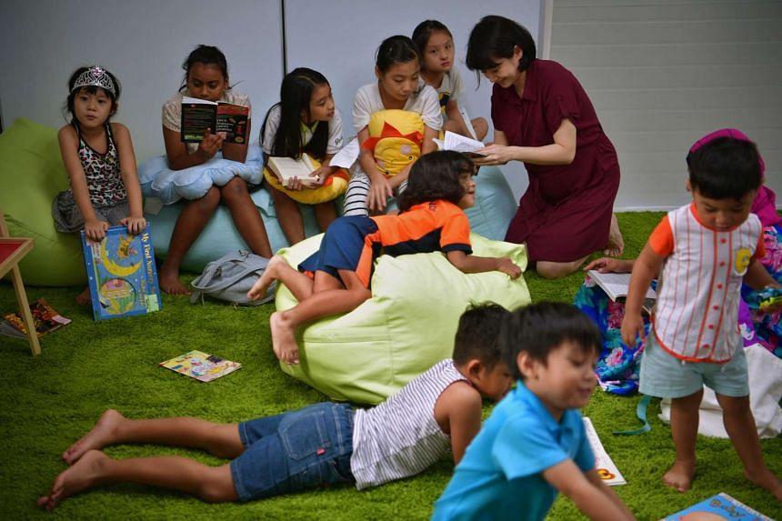 Pasir Ris-Punggol MP Sun Xueling speaks with children at the container library in Punggol West on Oct 12, 2016.