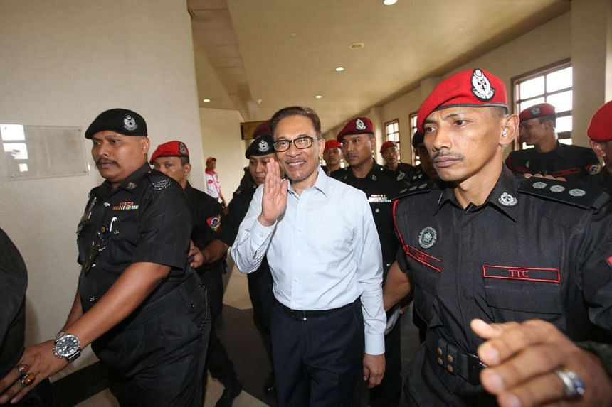 Anwar Ibrahim leaving the court in early September 2016.