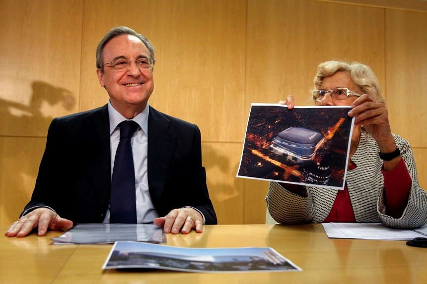 Mayor of Madrid Manuela Carmena and Real Madrid's president Florentino Perez attend a news conference to present a project they say aims to modernise the Santiago Bernabeu stadium at Madrid's City Hall, Spain on Oct 11, 2016.