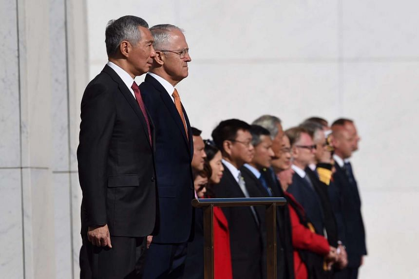 Prime Minister Lee Hsien Loong (left) and Australian Prime Minister Malcolm Turnbull inspect a guard of honour during a ceremonial welcome at Parliament House in Canberra.