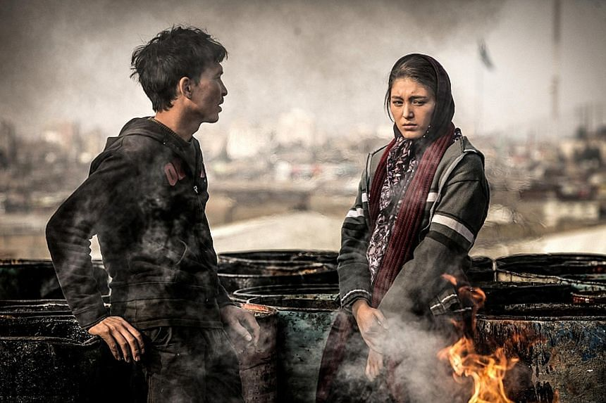 Parting, starring Reza Ahmadi (eft) and Fereshteh Hosseini, is about a married Afghan couple who reunite in Iran and plan to move to Europe.