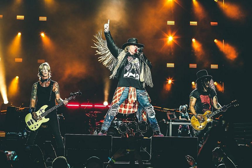 (From far left) Guns N' Roses bassist Duff McKagan, singer Axl Rose and guitarist Slash have reunited for the tour.