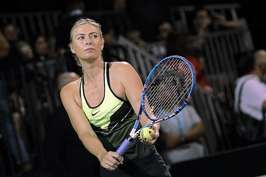 Maria Sharapova preparing to serve during the World Team Tennis Smash Hits charity event in Las Vegas on Monday.