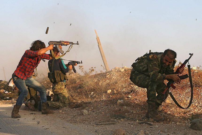 Free Syrian Army rebels battling Islamic State in Iraq and Syria militants in the Syrian village of Yahmoul north of the embattled city of Aleppo on Monday. At least 290 people have been killed in the Russian-backed Syrian government's onslaught on t