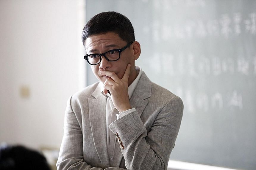 Lee Kang-sheng plays a gay professor who rents an apartment with his student lover in The Tenants Downstairs.