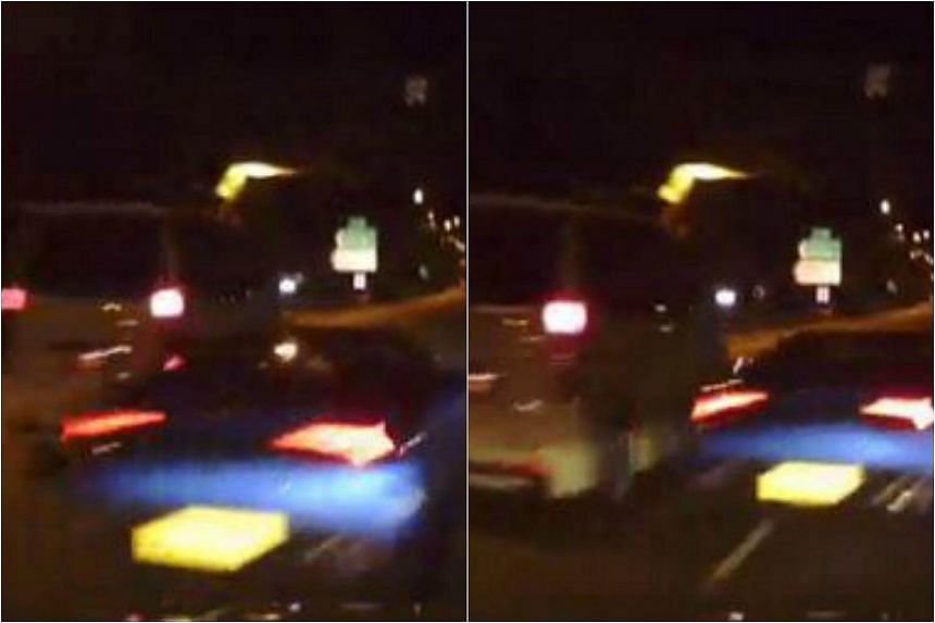 The blue Lamborghini was filmed whizzing through a narrow gap between two cars on the expressway.