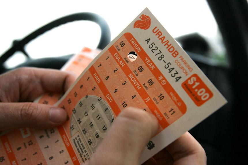 Posed photo of a person using parking coupons.