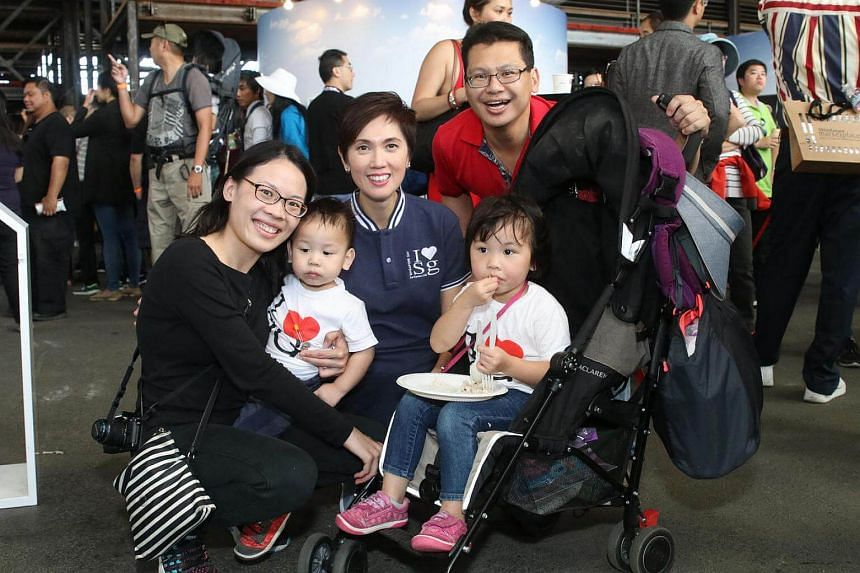File photograph of Senior Minister of State Josephine Teo mingling with a Singaporean family.