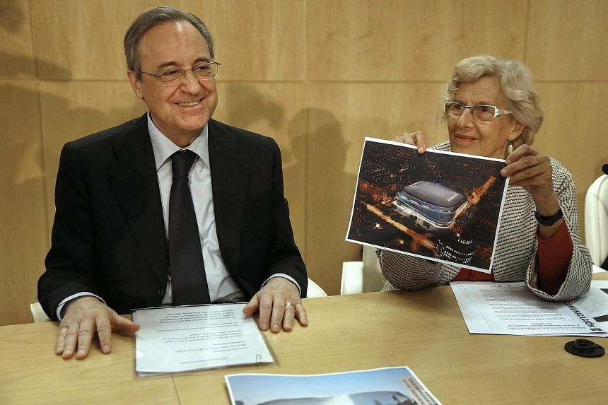 President of Real Madrid, Florentino Perez (left), and Mayoress of Madrid, Manuela Carmena, attend a briefing conference after signing an agreement to boost the modernization project of the Santiago Bernabeu stadium.