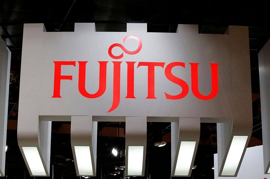Japanese IT giant Fujitsu said on Tuesday (Oct 11) it was planning to cut up to 1,800 jobs in Britain as part of a restructuring programme.
