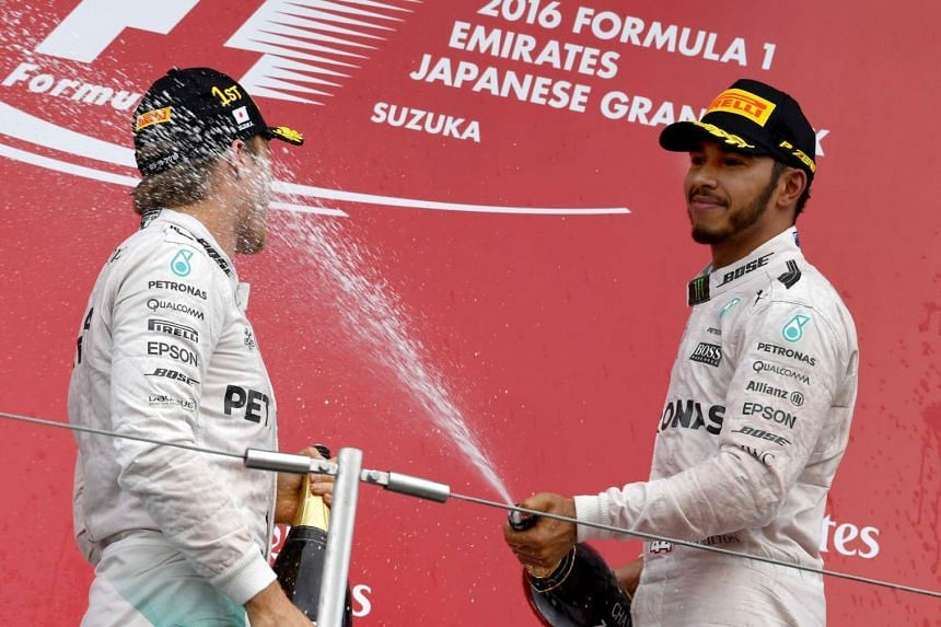 Rosberg is sprayed with champagne by Hamilton after the Japanese Grand Prix on Oct 9, 2016.