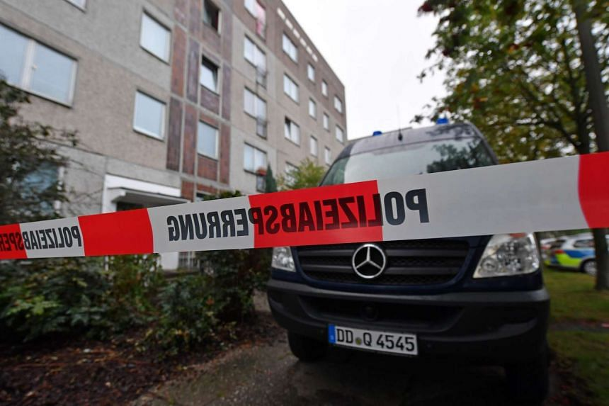 A barrier tape and a police vehicle of the criminal technology block the access to an house in the district of Paunsdorf in Leipzig on Oct 10, 2016.