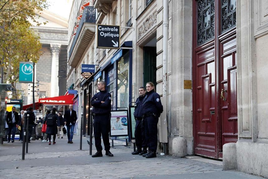 Police officers stand guard at the entrance to a hotel residence at the Rue Tronchet, central Paris on Oct 3, 2016, where Kim Kardashian was robbed at gunpoint.