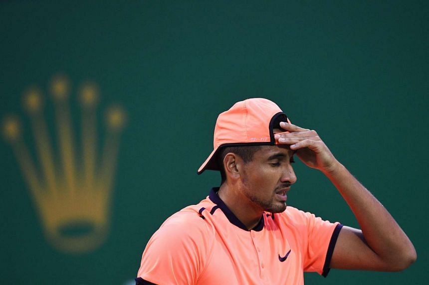 Nick Kyrgios of Australia reacts to his serve against Mischa Zverev of Germany during their men's singles match at the Shanghai Masters tennis tournament in Shanghai on Oct 12, 2016.