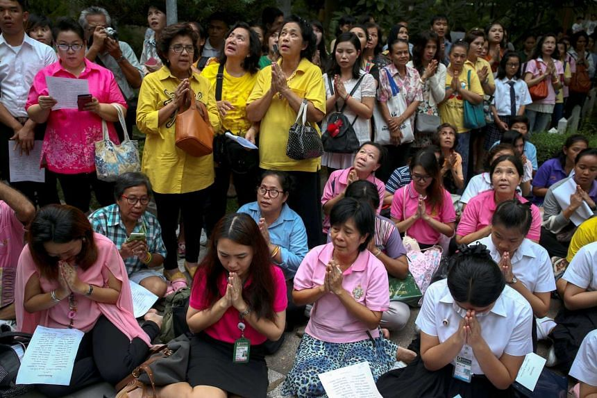 Well-wishers pray for Thailand's King Bhumibol Adulyadej at the Siriraj hospital where he is residing in Bangkok, Thailand on Oct 12, 2016.