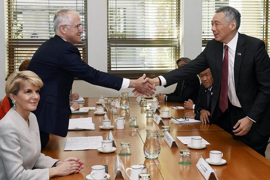 PM Lee Hsien Loong and Australian PM Malcolm Turnbull shake hands during a bilateral meeting at Canberra's Parliament House.