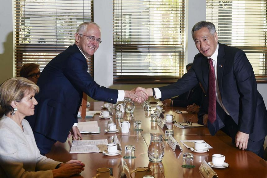 Prime Minister Lee Hsien Loong shakes hands with his Australian counterpart Malcom Turnbull during a bilateral meeting at Canberra's Parliament House.