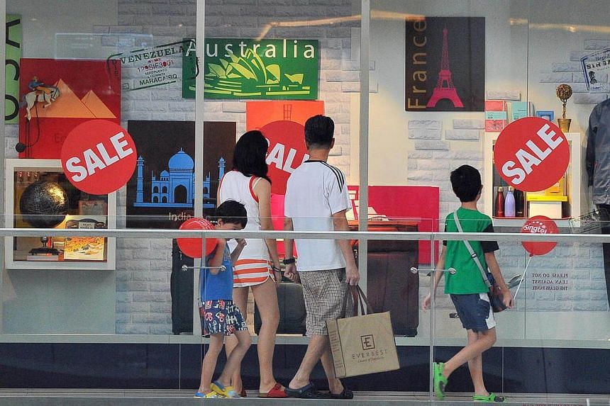 Shoppers walking past baby specialty store Mothercare's storefront at Marina Square during the Great Singapore Sale, on May 28, 2016.