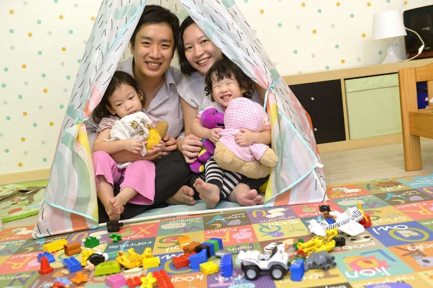 Civil servant Mrs Loh, with husband Melvin Loh, 34, and daughters Beth (left), three and Olivia, one. She hopes that those who take no-pay leave after birth will be able to remain in the same position they were in when they go back to work.