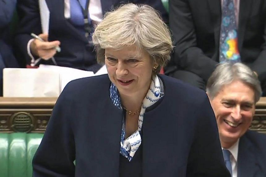 A video grab from footage broadcast by the UK Parliament's Parliamentary Recording Unit (PRU) shows British Prime Minister Theresa May as she speaks during Prime Minister's Questions (PMQs) in the House of Commons in London on Oct 12, 2016.