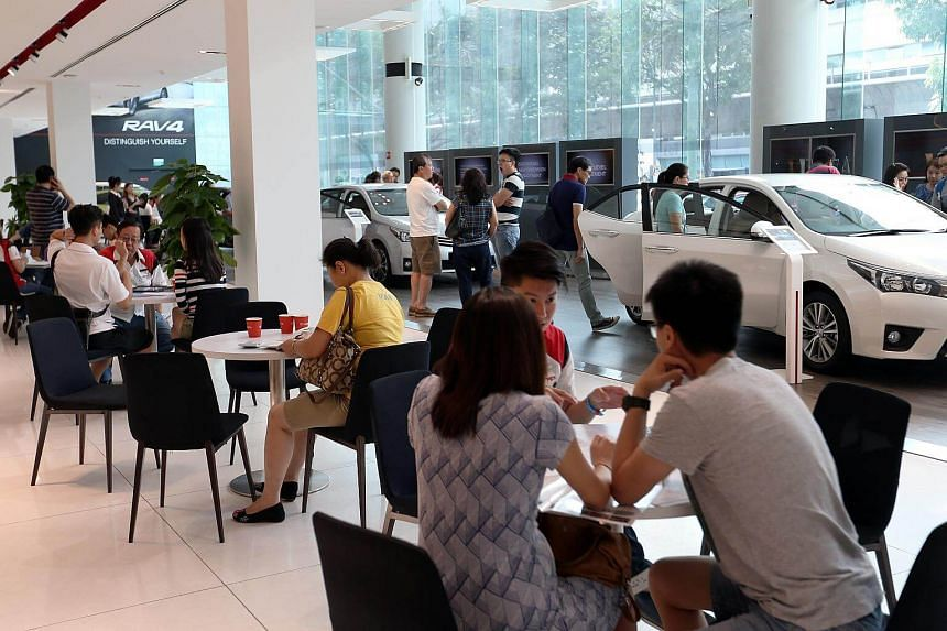 Potential car buyers at Borneo Motors' (Toyota) Leng Kee Showroom.