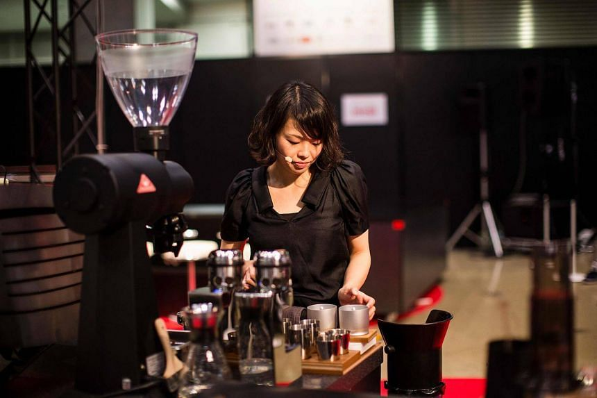 Miki Suzuki, winner of Japan's coffee Barista Championship, brews coffee during the competition in Tokyo.