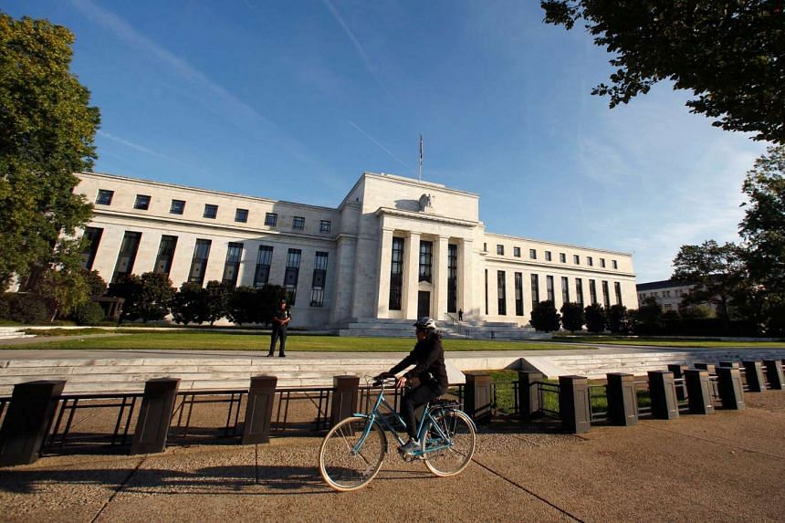 A cyclist passes the US Federal Reserve in Washington.