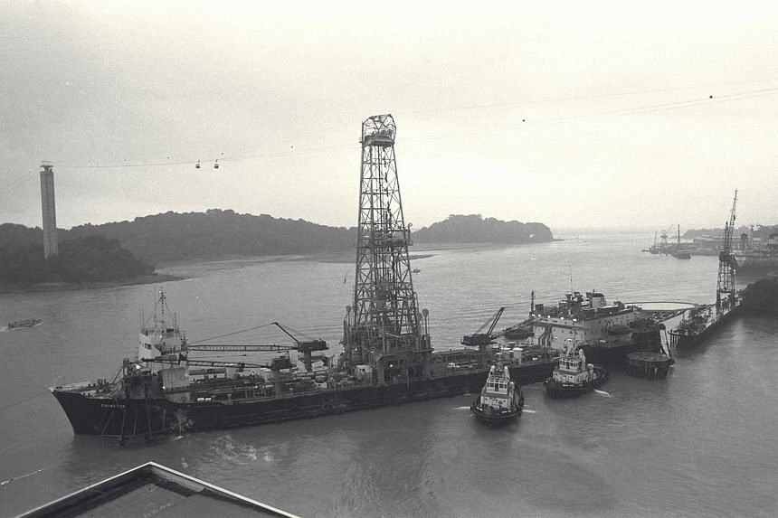 The derrick of the Panama-registered oil drilling vessel, Eniwetok, snagged one of the ropeways and sent two Sentosa cable cars plunging into the sea off Jardine Steps.