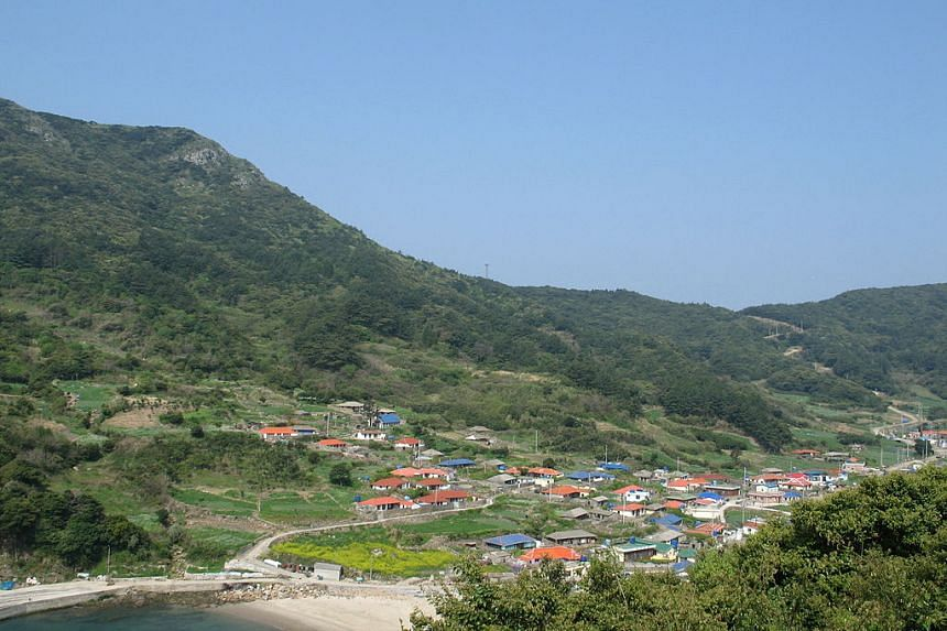 Three men were given prison sentences for raping their children's 20-year-old teacher in Heuksan, South Korea.