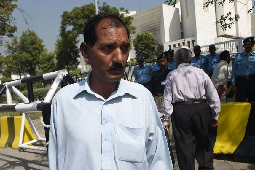 Ashiq Masih, husband of Christian woman Asia Bibi who faces the death sentence for blasphemy, leaves the Supreme Court in Islamabad on Oct 13, 2016.