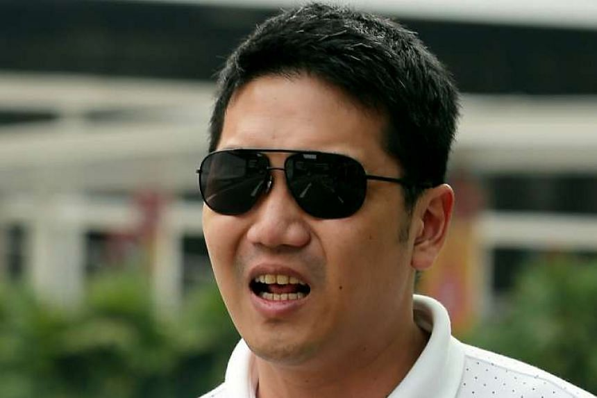 Woo Poh Liang was sentenced to 31 months and four weeks' jail, a $20,000 fine and ordered him to pay a penalty of $35,000 for taking bribes.