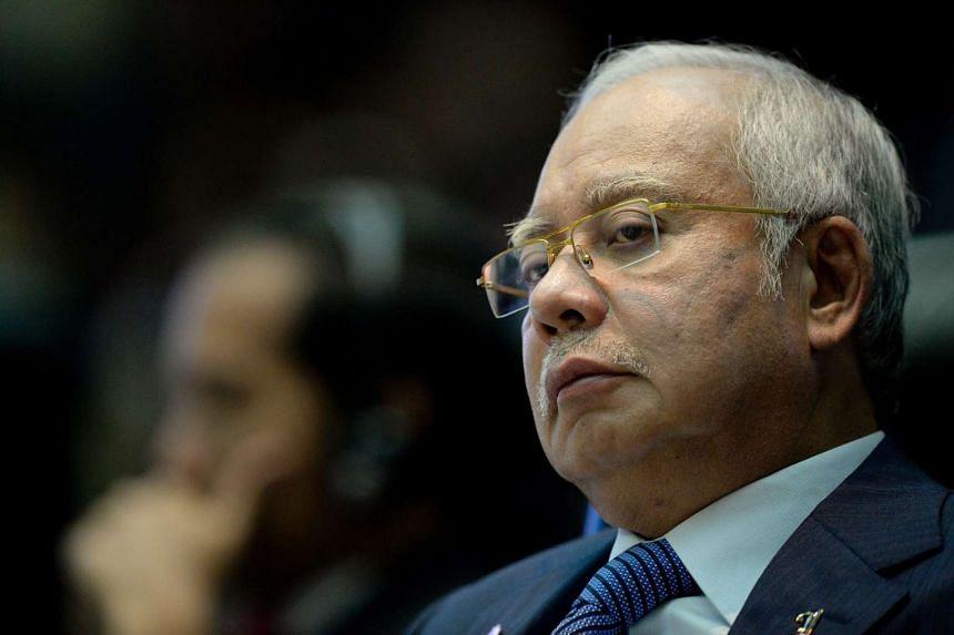Malaysia Prime Minister Najib Razak is battling criticism over his handling of a multi-billion dollar financial scandal at state fund 1Malaysia Development Berhad.