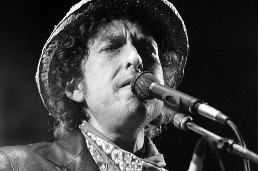US singer Bob Dylan performing during a concert at the Olympic stadium in Munich, southern Germany on June 3, 1984.