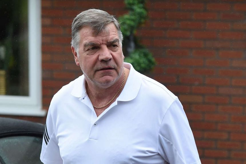 Former England national football team manager Sam Allardyce walks out of his home in Bolton on Sept 28, 2016.