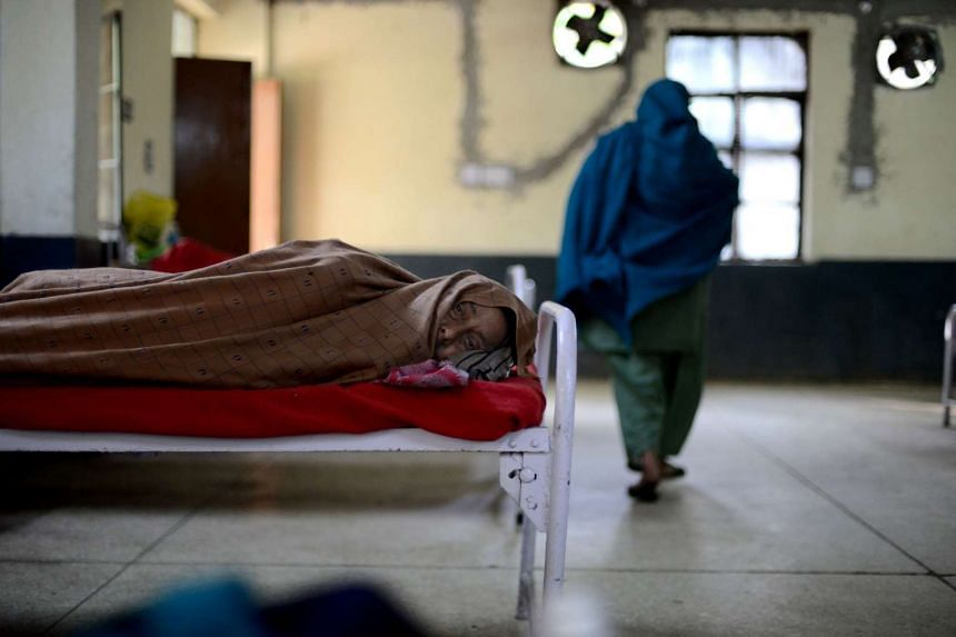 An Indian tuberculosis patient rests at The Rajan Babu Tuberculosis Hospital in New Delhi on March 24, 2014.