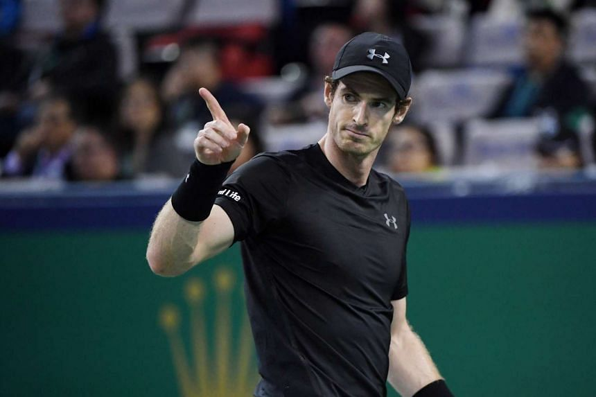Andy Murray reacts after winning a point against Lucas Pouille of France during their men's singles match at the Shanghai Masters tennis tournament on Oct 13, 2016.