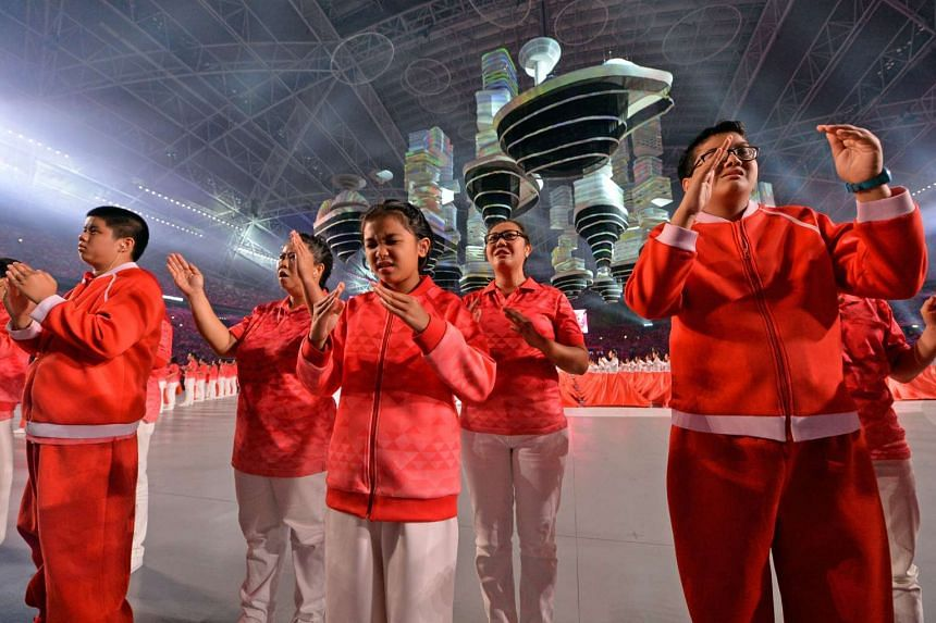 Participants with special needs practising sign language during a rehearsal for the National Day Parade 2016 at the National Stadium on July 30, 2016.