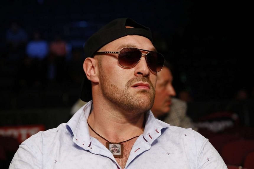 Tyson Fury's troubled 11th-month reign as world heavyweight champion came to an end on Thursday when the British boxer announced he would be vacating his WBO and WBA titles.