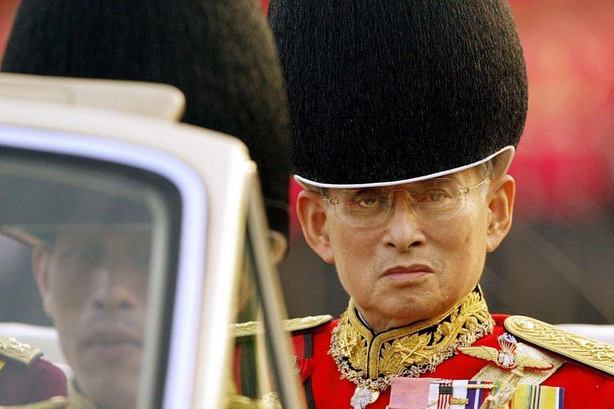 Thai King Bhumibol Adulyadej (right), inspecting the royal parade of honour in Bangkok on Dec 2, 2003.
