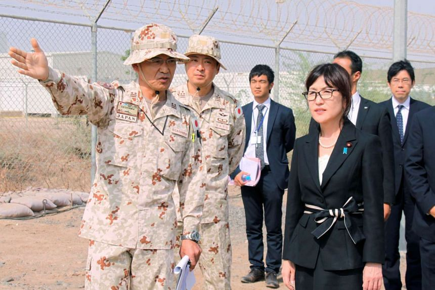 Japan's Defence Minister Tomomi Inada is briefed by senior Self-Defense Forces personnel about their anti-piracy mission off Somalia, in Djibouti.