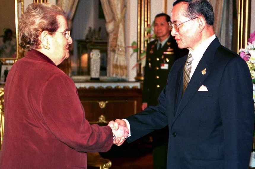 This file photo taken on March 3, 1999 shows then US Secretary of State Madeleine Albright (left) paying a courtesy call to King Bhumibol Adulyadej at the Chitrlada Palace in Bangkok.
