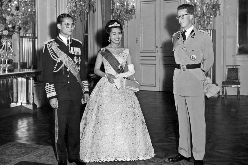 This file photo taken on Oct 4, 1960 shows Thai King Bhumibol Adulyadej (left) and Queen Sirikit (centre) standing near Belgium King Baudouin I during their official visit in Brussels.