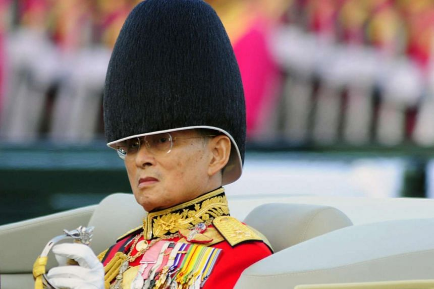 Thai King Bhumibol Adulyadej is shown Dec 2, 2007, as he is driven past a military parade on the Royal Plaza in Bangkok that kicked off celebrations for his 80th birthday on Dec 5.