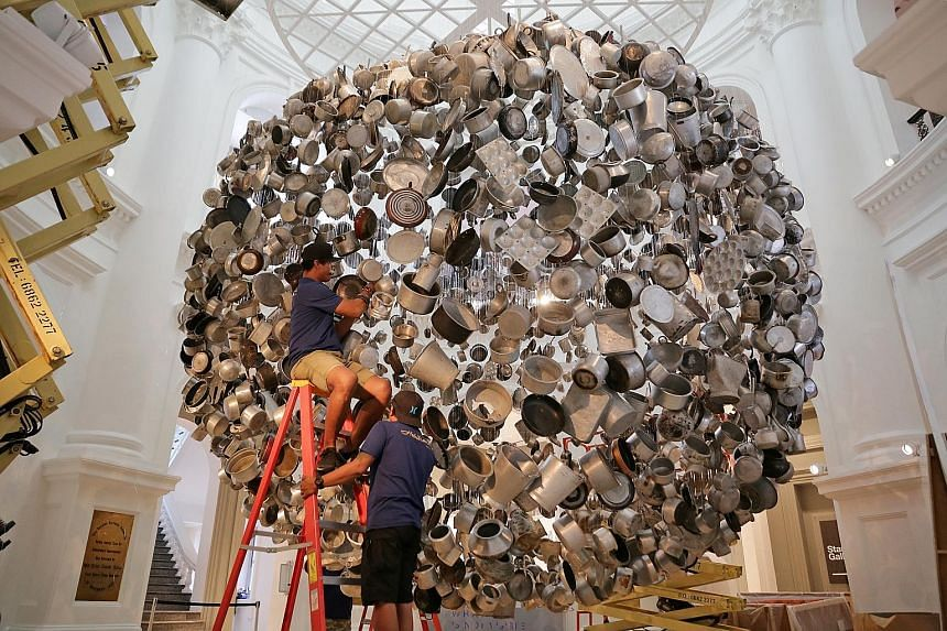 Cooking The World, by Indian artist Subodh Gupta, is one of the 60 works in the biennale. Dislocate by Vietnamese artist Bui Cong Khanh features delicate carpentry carved over two years.