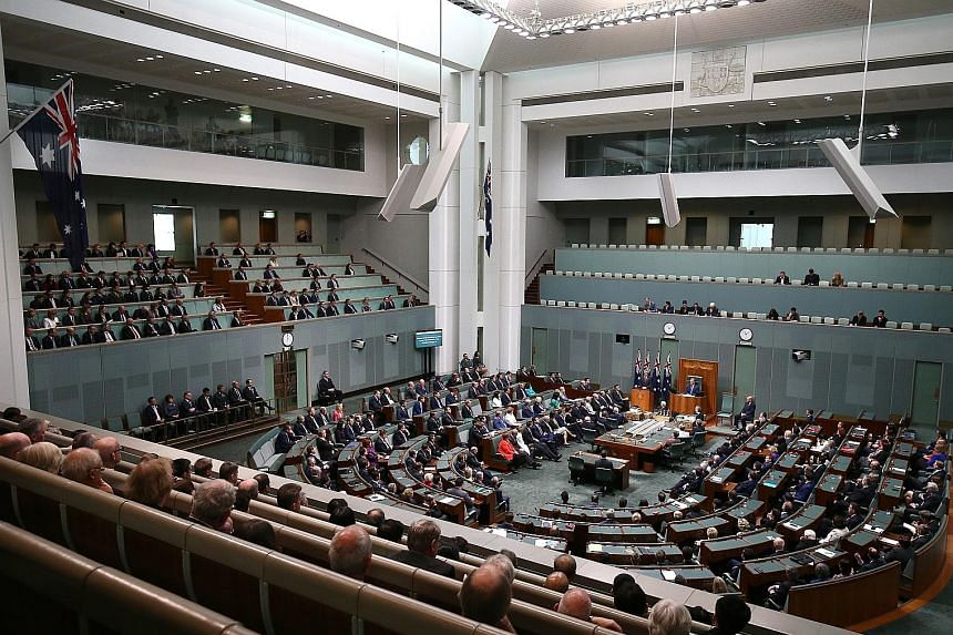 Australian lawmakers listening as Prime Minister Lee Hsien Loong delivered a historic address to the Australian Parliament yesterday.