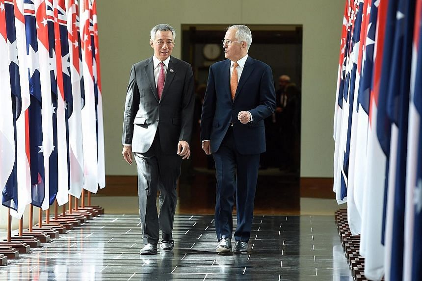 "PM Lee leaving Australia's Parliament House with Australian Prime Minister Malcolm Turnbull after his historic address yesterday. Mr Lee said the shared history, outlook and ethos between Singapore and Australia have formed the foundation of a ""deep,"