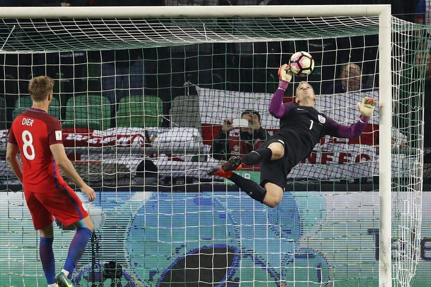 England midfielder Eric Dier watches as Joe Hart claws away a goalbound effort. Hart's saves earned England a 0-0 draw in Slovenia.