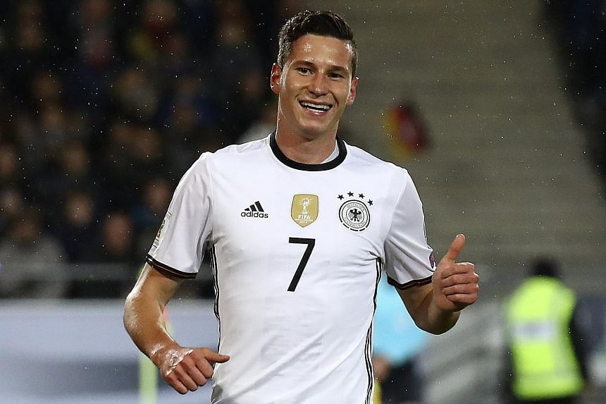 A happy Julian Draxler after opening accounts for Germany against Northern Ireland. Sami Khedira's goal wrapped up proceedings.